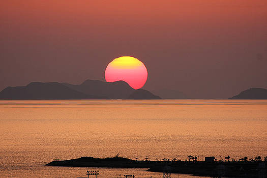 Sunset on Kerama Island by Francois Cantin