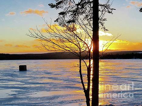 Sunset on the ice by Brenda Ketch