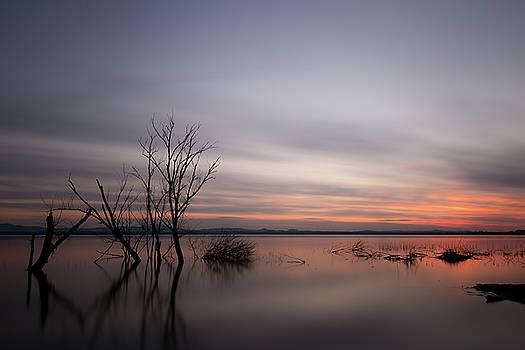 Sunset on the lake by Massimo Discepoli