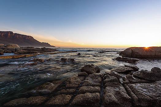 Sunset on the Rocks by Jose Vazquez