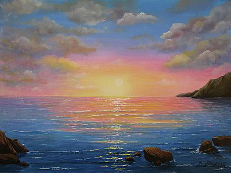 Sunset on the shore by Debra Dickson