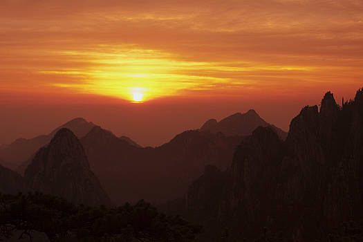 Sunset on the Yellow mountains Huangshan China by Kamala Saraswathi