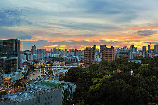 Sunset over Clarke Quay and Fort Canning Park by David Gn