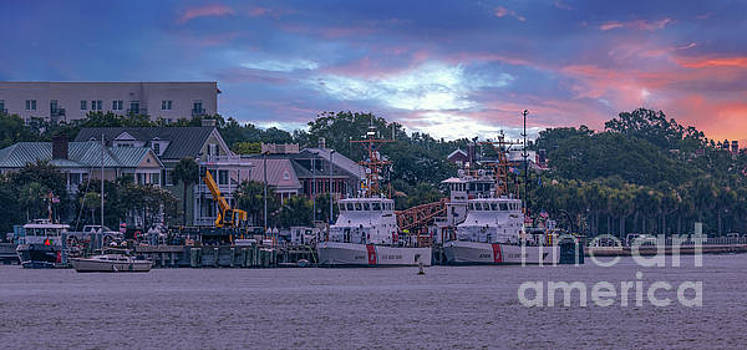 Sunset over Coast Guard Charleston  by Dale Powell