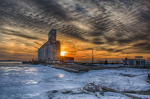 Sunset Over Frozen Lake Erie by Guy Whiteley