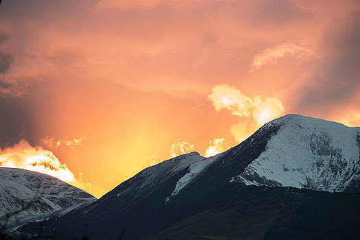 Sunset over Grisedale Pike and The Coledale Horsehoe, Lake Distr by Russell Millner