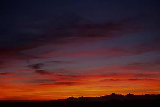 Sunset over Olympic Mountain Range by John Clark