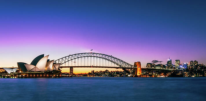 Sunset over Opera House and the Harbour Bridge in Sydney, Australia by Daniela Constantinescu