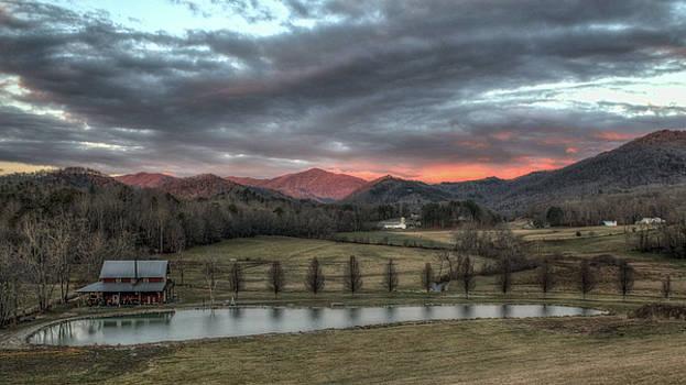 Sunset Over The Farm by Johnny Crisp