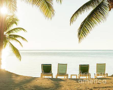 Tim Hester - Sunset Over Tropical Beach Deckchairs