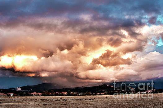 Sunset Rain Clouds by Janie Johnson