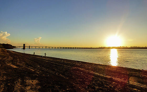 Sunset reflecting on the Uruguay river by Helissa Grundemann