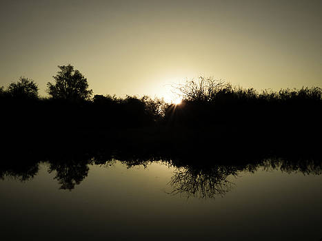 Sunset reflecting on water by Helissa Grundemann