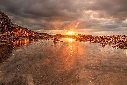 Sunset reflection by Gouzel -