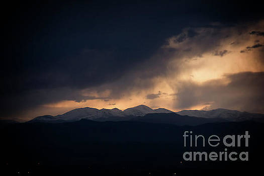 Sunset storm over the Rockies by Bob Hislop