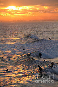 Sunset Surfers Huntington Beach by Linda Queally
