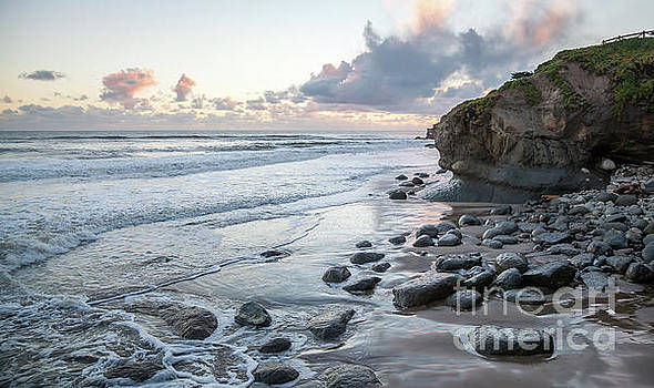 Sunset View in the distance with Large Rocks on the Beach by PorqueNo Studios