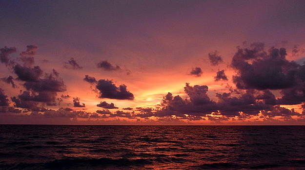 Sunset with deep purple clouds by John Myers