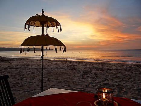 Sunset with umbrella by Exploramum Exploramum