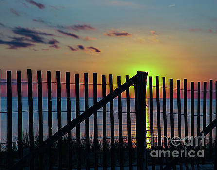 Sunset with wooden fence by Miro Vrlik