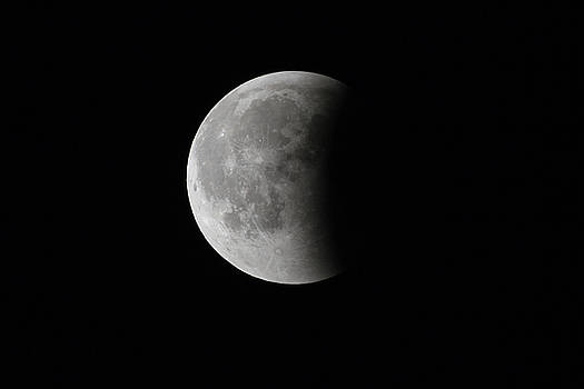 Super Bloody Moon, full eclipse last phase against black sky background by Lukasz Szczepanski
