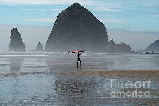 Surfer at Haystack Rock by Loriannah Hespe