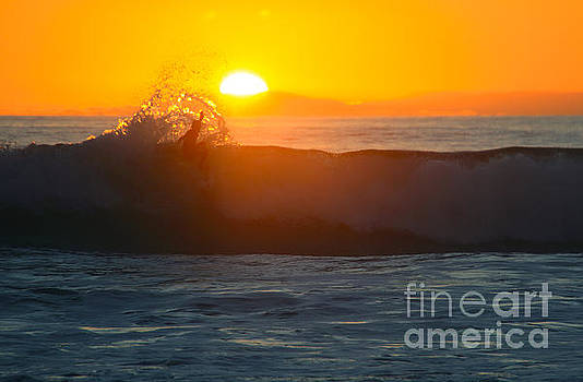 Surfer at Sunset by E Williams