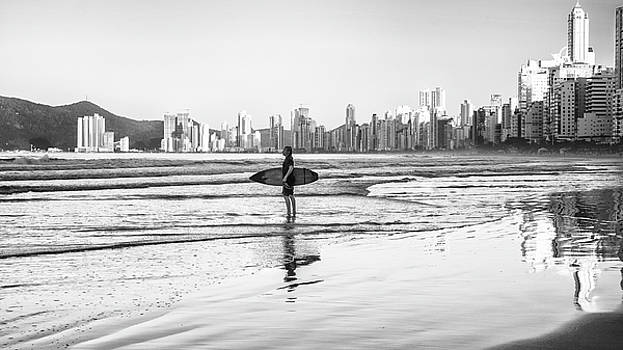 Surfer on the beach by Jose Maciel