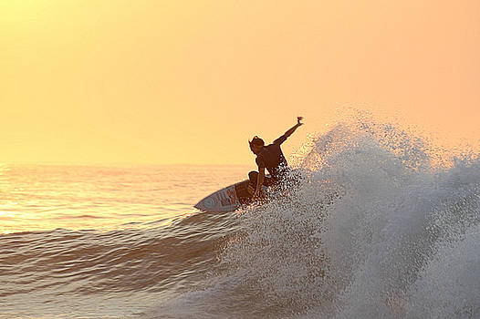 Surfing In Golden Sky by Robert Banach