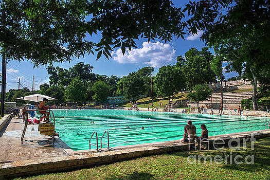 Herronstock Prints - Swimmers swim laps while others relax at Deep Eddy Pool, the perfect prescription to beat Texas brutal summer 100 degree heat wave