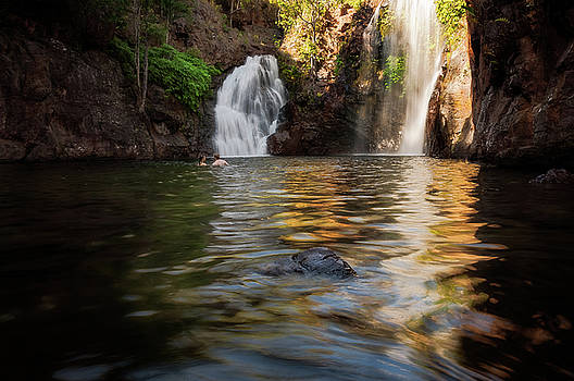 Swimming at Florence Falls in Litchfield NP, Australia by Daniela Constantinescu