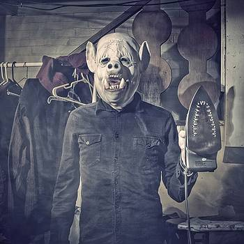 Swine - Man In Pig Mask With Iron by Dylan Murphy