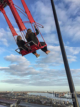 Swing high above with a view of Amsterdam by Patricia Hofmeester