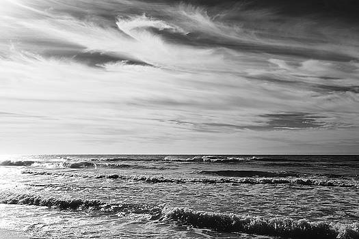Swirling Clouds at the Beach by Jim Clark