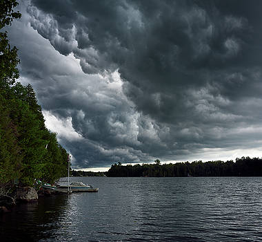 Reimar Gaertner - Swirling dark clouds before a thunderstorm over Lake Cecebe in c