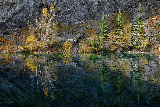 Reimar Gaertner - Symmetrical reflections of fall trees on Grassi Lakes Canmore