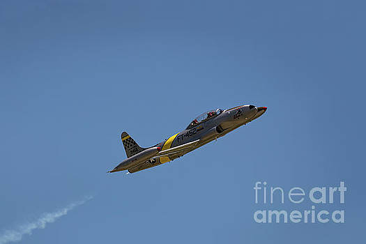 T33 in Flight by Andrea Silies
