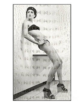 Tall girl leaning on wall in changeroom by Michael Edwards