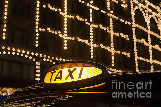 Taxi in London in front of a shopping center by Deyan Georgiev