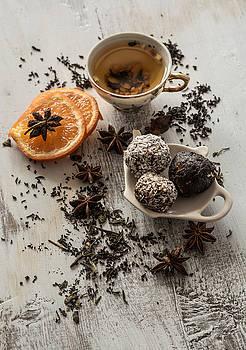 Tea, dried cinnamon, vegan cookies ,orange and anise on wooden b by Julian Popov