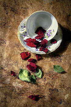 Teacup and Red Rose Petals by Eleanor Caputo