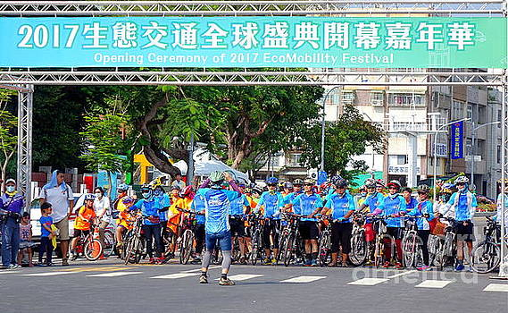 Team of Cyclists Join Parade by Yali Shi