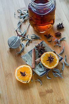 Tea,tea stainer, dried cinnamon, vegan cookies and anise on wood by Julian Popov