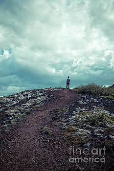 Teenager on a hiking trail in Iceland by Edward Fielding