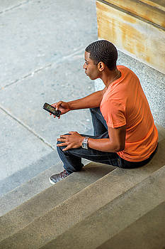 Alexander Image - Black Boy Texting Outside