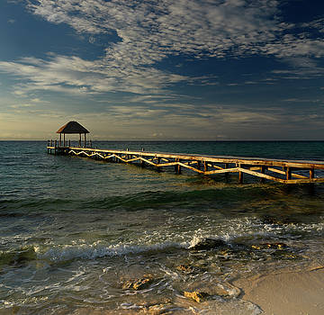 Reimar Gaertner - Thatched roof gazebo on the end of a dock on the Mayan Riviera a
