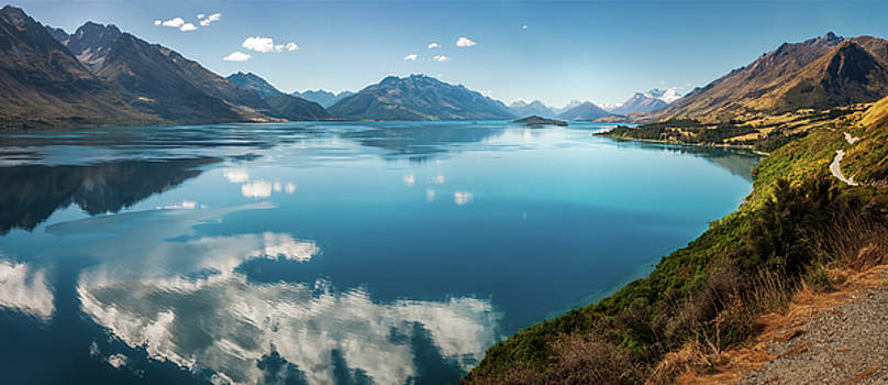 The blue waters of Lake Wakatipu in New Zealand with reflections by Daniela Constantinescu