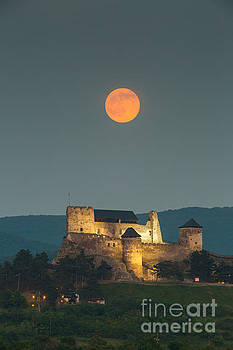 The castle of Boldogko at full moon by Gabor Pozsgai