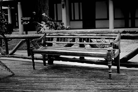 The classic wooden chair in the garden by Adirek Kata