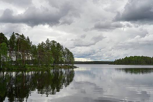 The Clouds over the Calm Lake. Koirajarvi by Jouko Lehto